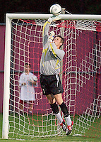 MetroStars goal keeper Jonny Walker pushes a ball over the bar. The New England Revolution were defeated by the NY/NJ MetroStars 2-1 during quarterfinals action of the Lamar Hunt U.S. Open Cup on 8/27/03 at Yurcak Field, Rutgers University, Piscataway, NJ..