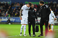 Joe Rodon of Swansea City leaves the pitch injured during the Sky Bet Championship match between Swansea City and Sheffield United at the Liberty Stadium in Swansea, Wales, UK. Saturday 19 January 2019