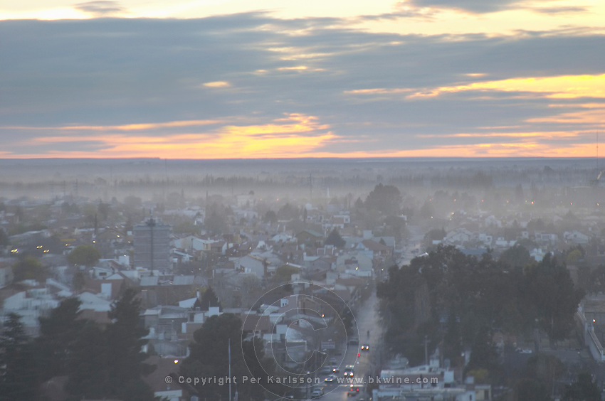 Sunset view over the city with mist fog bird's eye Neuquen, Patagonia, Argentina, South America