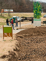 NWA Democrat-Gazette/BEN GOFF @NWABENGOFF<br /> A crew from Fresh-N-Green Landscape Company based in Springdale plants daffodil bulbs Tuesday, Dec. 4, 2018, at Lake Bella Vista Park in Bentonville. A Walton Family Foundation grant at the recommendation of Steuart Walton is supporting a beautification project to plant 300,000 daffodil bulbs at sites in Bentonville this week. The 300,000 bulbs include 20 varieties of daffodils. Sites to be planted include the North Bentonville trail, sites on the Razorback Regional Greenway, the Seed Tick Shuffle trail at Slaughter Pen, the traffic circle on John DeShields Boulevard and Orchards Park.