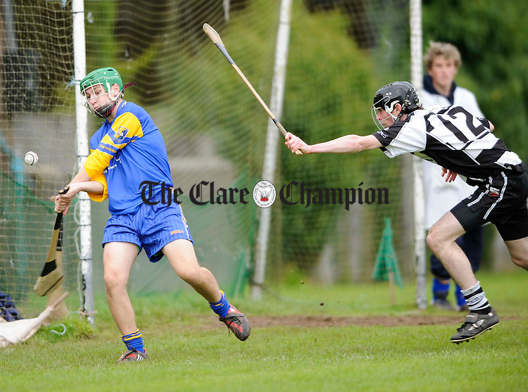 Sixmilebridge's Steven Fleming in action against Clarecastle's Patrick Casey during their minor championship semi final at Clareabbey. Photograph by John Kelly.