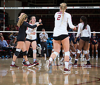 STANFORD, CA - December 1, 2018: Meghan McClure, Morgan Hentz, Kathryn Plummer, Tami Alade at Maples Pavilion. The Stanford Cardinal defeated Loyola Marymount 25-20, 25-15, 25-17 in the second round of the NCAA tournament.