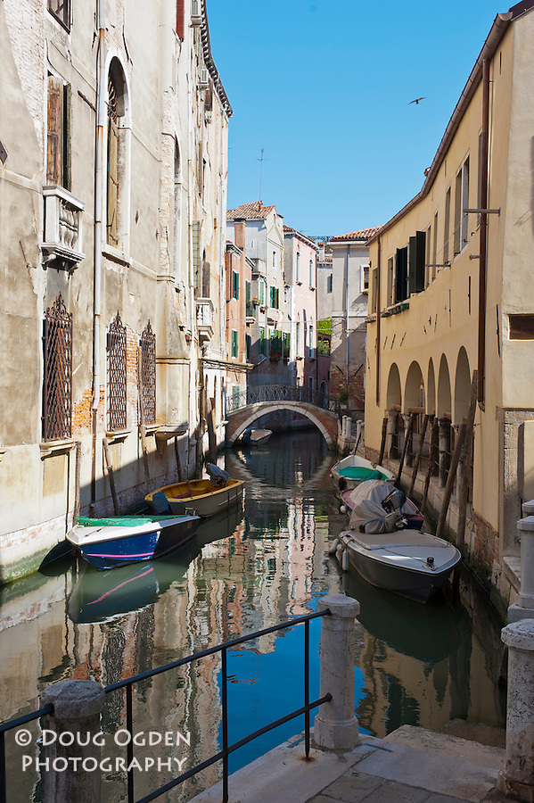Reflection in a side canal, Venice, Italy