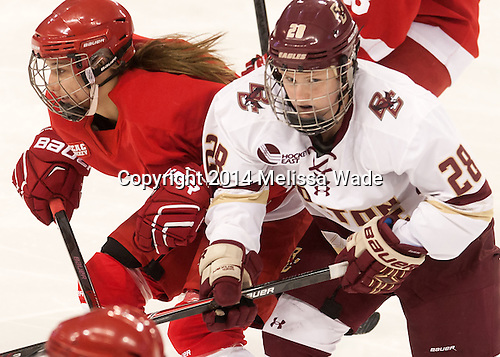 Sydney Smith (Cornell - 23), Kate Leary (BC - 28) - The Boston College Eagles defeated the visiting Cornell University Big Red 6-2 on Friday, October 24, 2014, at Kelley Rink in Conte Forum in Chestnut Hill, Massachusetts.