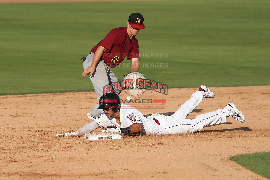 Wisconsin Timber Rattlers outfielder Brandon Diaz (5) slides in to second base as Quad Cities River Bandits shortstop Alex Bregman (8) takes the throw during a Midwest League game on July 17th, 2015 at Fox Cities Stadium in Appleton, Wisconsin. Quad Cities defeated Wisconsin 4-2. (Brad Krause/Four Seam Images)