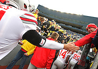 An OSU fan who goes as Tennessee Jeff waded into the Michigan crowd to high five Buckeyes as they head into the tunnel prior to the start of the game at Michigan Stadium on November 28, 2015. (Chris Russell/Dispatch Photo)