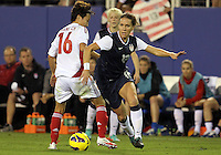 BOCA RATON, FL - DECEMBER 15, 2012: Lauren Cheney (12) of the USA WNT pushes away from Wang Chen (16) of China WNT during an international friendly match at FAU Stadium, in Boca Raton, Florida, on Saturday, December 15, 2012. USA won 4-1.