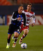 Colorado midfielder Clint Mathis pushes the ball ahead of FC Dallas's Simo Valakari. The Colorado Rapids and FC Dallas played to a 2-2 draw at Invesco Field at Mile High Stadium in Denver, CO, April 15, 2006.