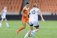 Houston, TX - Saturday July 08, 2017: Poliana Barbosa Medeiros brings the ball up the field during a regular season National Women's Soccer League (NWSL) match between the Houston Dash and the Portland Thorns FC at BBVA Compass Stadium.