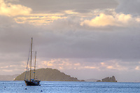Dusk looking out towards Carvel Rock with a sailboat at anchor<br /> U.S. Virgin Islands