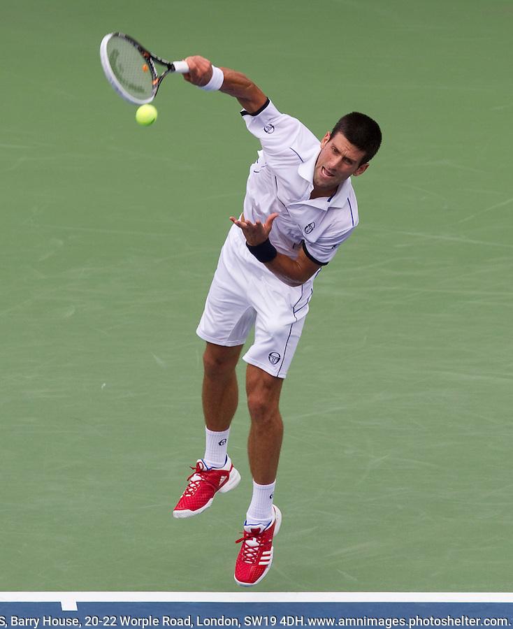 NOVAK DJOKOVIC (SRB) (1) against ROGER FEDERER (SUI) (1) in the Semi-Finals of the Men's SIngles. Novak Djokovic beat Roger Federer 6-7 4-6 6-3 6-2 7-5..Tennis - Grand Slam - US Open - Flushing Meadows - New York - Day 13 - September 10th  2011..© AMN Images, Barry House, 20-22 Worple Road, London, SW19 4DH, UK..+44 208 947 0100.www.amnimages.photoshelter.com.www.advantagemedianetwork.com.