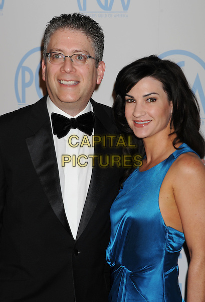Bill Prady & guest.The 23rd Annual Producers Guild Awards at the Beverly Hilton Hotel in Beverly Hills, California, USA..January 21st, 2012.half length black tuxedo blue dress .CAP/ROT/TM.©Tony Michaels/Roth Stock/Capital Pictures