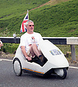 Grand Depart - Tour de France 2014<br /> Yorkshire England.<br /> Second stage passes through &quot;Blubberhouses Moor&quot;<br /> on the road from Harrogate<br /> Cycling fan in a Sinclair C5<br /> <br /> <br /> Pic by Gavin Rodgers/Pixel 8000 Ltd
