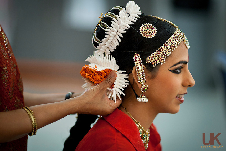 Sulatha helping Pranati get ready for her Arangetram. Pranati getting ready before her Arangetram at the Eisemann Center