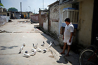 Folk sportsmen or Kabutarbaaz nurture and train pigeons to obey their commands to fly and return to home. Contests and competitions are held at the town and regional level where winners are declared Ustads and Khalifas. This folk sport is popular in North West India. Seen here is the kabutar-baaz or the sportsman outside his home.
