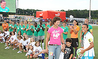 Marta #10 of Marta's XI with Michelle Akers during the WPS All-Star game at KSU Stadium in Kennesaw, Georgia on June 30 2010. Marta XI won 5-2.