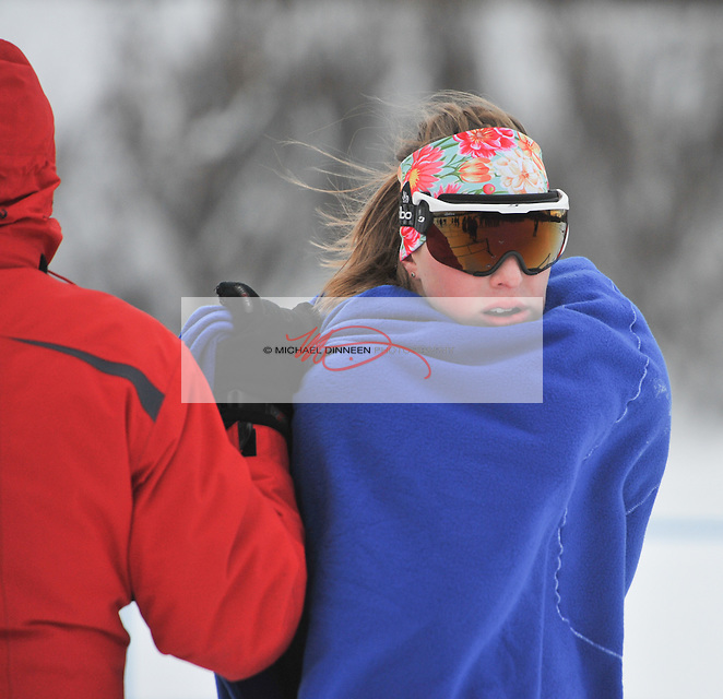 Chugiak&rsquo;s Heidi <br /> Booher tries to keep warm prior to a sprint race during the Service Snowball races at Kincaid Park Saturday, Dec. 3, 2016.  Photo by Michael Dinneen for the Star.