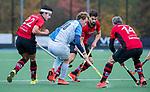 ZEIST- Casper van Loon (Hurley) met Jelle Pfijffer (Schaerweijde) , Dominic Aarts (Schaerweijde) en Ronald Brouwer (Schaerweijde)   promotieklasse hockey heren, Schaerweijde-Hurley (4-0)  COPYRIGHT KOEN SUYK