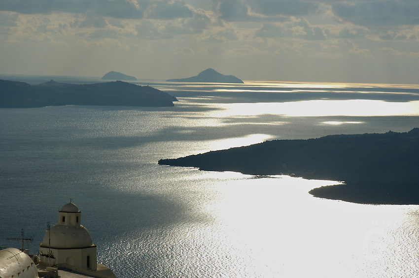 the shimmering ocean view from the island of Santorini, Greece