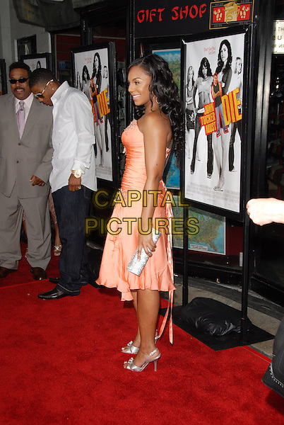 """NELLY & ASHANTI.Los Angeles Premiere of """"John Tucker Must Die"""" held at The Grauman's Chinese Theatre in Hollywood, California  .July 25th, 2006.Ref: DVS.full length coral peach pink satin dress silver shoes clutch purse strapless.www.capitalpictures.com.sales@capitalpictures.com.©Debbie VanStory/Capital Pictures"""