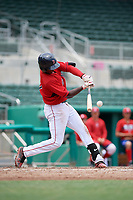 GCL Red Sox shortstop Jecorrah Arnold (17) hits a single during a game against the GCL Rays on August 1, 2018 at JetBlue Park in Fort Myers, Florida.  GCL Red Sox defeated GCL Rays 5-1 in a rain shortened game.  (Mike Janes/Four Seam Images)