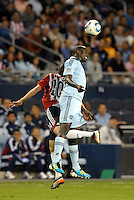 Sporting KC defender Lawrence Olum (13) wins the header against Carlos Fierro  Chivas Guadlajara... Sporting Kansas City and Chivas Guadalajara played to a 2-2 tie in an international friendly at LIVESTRONG Sporting Park, Kansas City, Kansas.