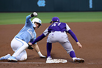 CHAPEL HILL, NC - FEBRUARY 19: Adam Stuart #47 of High Point University tags out Danny Serretti #1 of the University of North Carolina attempting to steal third base during a game between High Point and North Carolina at Boshamer Stadium on February 19, 2020 in Chapel Hill, North Carolina.