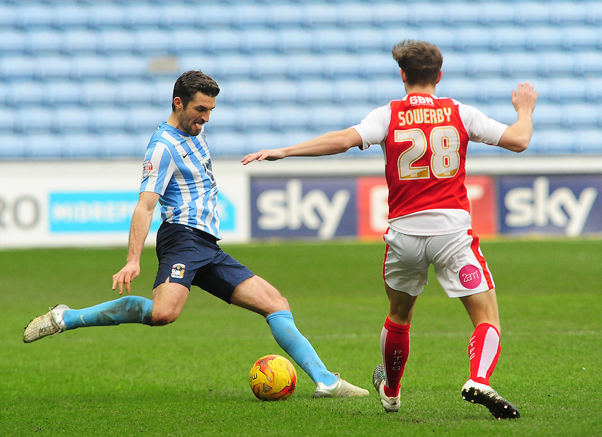 Coventry City's Sam Ricketts plays the ball forward under pressure from Fleetwood Town's Jack Sowerby<br /> <br /> Photographer Andrew Vaughan/CameraSport<br /> <br /> Football - The Football League Sky Bet League One - Coventry City v Fleetwood Town - Saturday 27th February 2016 - Ricoh Stadium - Coventry   <br /> <br /> &copy; CameraSport - 43 Linden Ave. Countesthorpe. Leicester. England. LE8 5PG - Tel: +44 (0) 116 277 4147 - admin@camerasport.com - www.camerasport.com