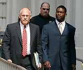 Atlanta Falcons football player Michael Vick leaves federal court with his attorney after pleading guilty in a dogfighting case in Richmond, Va., Monday, Aug. 27, 2007.  (AP Photo/Steve Helber/POOL)
