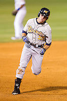 Kes Carter (39) of the Montgomery Biscuits hustles towards third base against the Chattanooga Lookouts at AT&T Field on July 24, 2014 in Chattanooga, Tennessee.  The Biscuits defeated the Lookouts 6-4. (Brian Westerholt/Four Seam Images)
