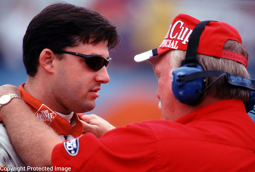 Tony Stewart talks with a Winston Cup official before qualifying for the Checker Auto Parts/Duralube 500K at Phoenix International Raceway in November 2000. (Photo by Brian Cleary)