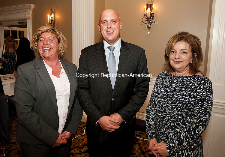 WATERTOWN,  CT-110216JS11- Kim Curry; Michael Dayton and Rosemary Briglia, all with Thomaston Savings Bank, at the Watertown-Oakville Chamber of Commerce's annual meeting and awards dinner held  at the Grand Oak Villa in Watertown.  <br /> Jim Shannon Republican American