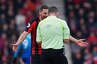 Dan Gosling of AFC Bournemouth remonstrates with Referee Kevin Friend  after receiving a yellow card during AFC Bournemouth vs Arsenal, Premier League Football at the Vitality Stadium on 14th January 2018