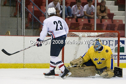Colin Wilson (US White - 23), Mark Owuya (Sweden 30) - Team Sweden defeated Team USA White 7-3 on Friday, August 8, 2008, in the 1980 Rink during the 2008 US National Junior Evaluation Camp and Summer Hockey Challenge in Lake Placid, New York.