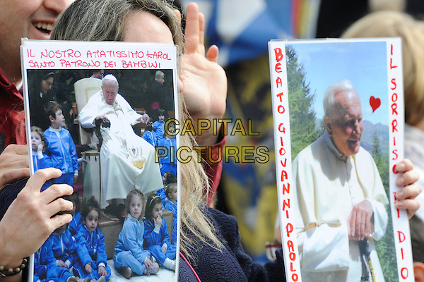 ATMOSPHERE .Pope Benedict XVI celebrated Easter Mass in St. Peter's Square, Rome, Italy, Easter Sunday, April 24th 2011..atmosphere crowd Easter catholic religious religion GV general view g.v. posters .CAP/EPS/GG.©Giuseppe Giglia/EPS/Capital Pictures.