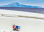 5 December 2014: Semen Pavlichenko, sliding for Russia, is thrown from his sled as he slides through Curve Number 14 on his first run, ending the day with combined 2-run time of 1:53.207 in the Men's Competition at the Viessmann Luge World Cup, at the Olympic Sports Track in Lake Placid, New York, USA. Mandatory Credit: Ed Wolfstein Photo *** RAW (NEF) Image File Available ***