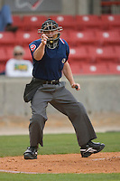 Home plate umpire Sean Barber makes a strike call during the Southern League contest between the Jacksonville Suns and the Carolina Mudcats at Five County Stadium May 18, 2009 in Zebulon, North Carolina. (Photo by Brian Westerholt / Four Seam Images)