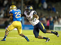 Ted Agu of California tackles Damien Thigpen of UCLA during the game at Rose Bowl in Pasadena, California on October 12th, 2013.   UCLA defeated California, 37-10.