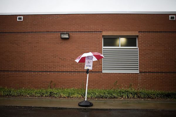 November 4, 2008. Raleigh, NC.. As voters hit the polls in the heavily contested state of North Carolina, turnout was high, even given the rainy weather throughout the state.. A curbside voting sign stands in the rain outside a busy Raleigh voting precinct.