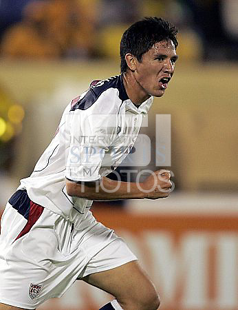 Brian Ching celebrates his goal against Jamaica in the second half at National Stadium, in Kingston, Jamaica, Wednesday, Aug. 18, 2004. Tie game 1-1.