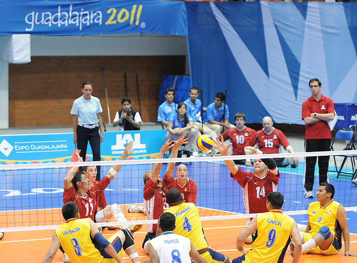 November 18 2011 - Guadalajara, Mexico:  Jose Rebelo, Austin Hinchey and Greg Stewart of Team Canada are set to block while taking on Columbia in the Bronze Medal Game in the Pan American Volleyball Complex at the 2011 Parapan American Games in Guadalajara, Mexico.  Photos: Matthew Murnaghan/Canadian Paralympic Committee