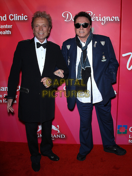 """Siegrfried and Roy (Siegfried Fischbacher & Roy Horn).Keep Memory Alve """"Power of Love Gala"""" at MGM Grand Garden Arena, Las Vegas, Nevada, USA..February 18th, 2012.full length tuxedo black white blue suit shirt scarf sunglasses shades .CAP/ADM/MJT.© MJT/AdMedia/Capital Pictures."""