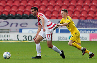 Fleetwood Town's Ashley Hunter chases down Doncaster Rovers' Matty Blair<br /> <br /> Photographer David Shipman/CameraSport<br /> <br /> The EFL Sky Bet League One - Doncaster Rovers v Fleetwood Town - Saturday 6th October 2018 - Keepmoat Stadium - Doncaster<br /> <br /> World Copyright &copy; 2018 CameraSport. All rights reserved. 43 Linden Ave. Countesthorpe. Leicester. England. LE8 5PG - Tel: +44 (0) 116 277 4147 - admin@camerasport.com - www.camerasport.com