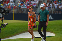 Jena sims and Brooks Koepka (USA) are all smiles as they depart the green on 18 after winning the 100th PGA Championship at Bellerive Country Club, St. Louis, Missouri. 8/12/2018.<br /> Picture: Golffile | Ken Murray<br /> <br /> All photo usage must carry mandatory copyright credit (&copy; Golffile | Ken Murray)