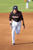 Trey Michalczewski (27) of the Kannapolis Intimidators hustles towards third base against the Hagerstown Suns at CMC-Northeast Stadium on June 1, 2014 in Kannapolis, North Carolina.  The Suns defeated the Intimidators 11-5 in game two of a double-header.  (Brian Westerholt/Four Seam Images)