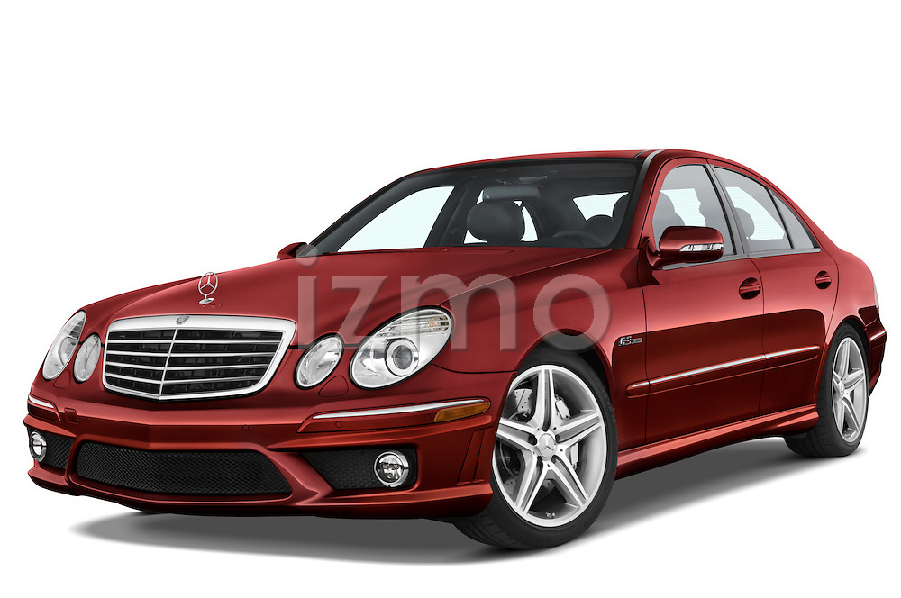 Low aggressive front three quarter view of a red 2008 Mercedes E63 Sedan.