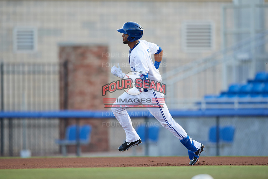 Dunedin Blue Jays shortstop Lourdes Gurriel (13) rounds first base on a double in his first at bat during a game against the St. Lucie Mets on April 19, 2017 at Florida Auto Exchange Stadium in Dunedin, Florida.  Dunedin defeated St. Lucie 9-1.  (Mike Janes/Four Seam Images)