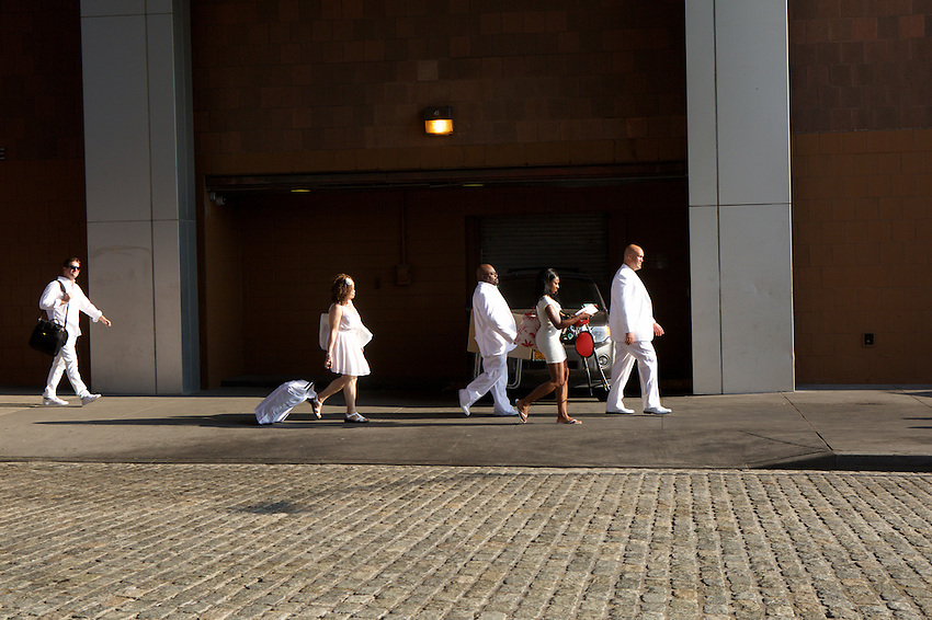 New York, NY - July 28, 2015: Diner en Blanc attendees walk through TriBeCa to the annual pop-up dinner party. CREDIT: Clay Williams for Diner en Blanc<br /> <br /> &copy; Clay Williams / claywilliamsphoto.com