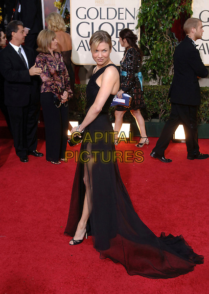 RENEE ZELLWEGER.63rd Annual Golden Globe Awards - Arrivals held at the Beverly Hills Hilton, Beverly Hills, California, USA..January 16th, 2006.Ref: AW.globes full length black dress sheer slit split looking over shoulder.www.capitalpictures.com.sales@capitalpictures.com.Supplied By Capital Pictures.