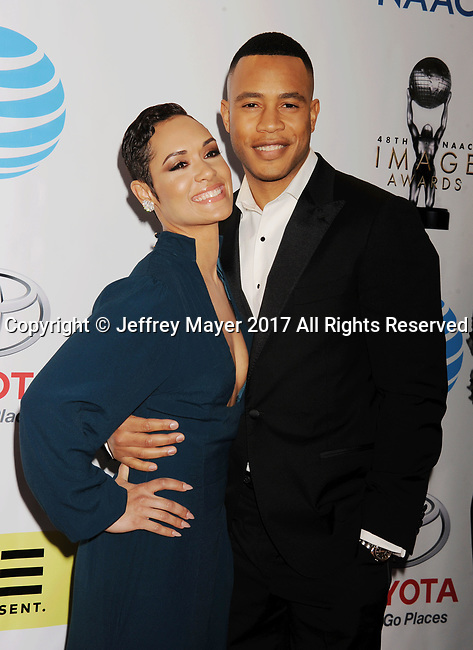 PASADENA, CA - FEBRUARY 11: Actors Grace Gealey (L) and Trai Byers arrive at the 48th NAACP Image Awards at Pasadena Civic Auditorium on February 11, 2017 in Pasadena, California.